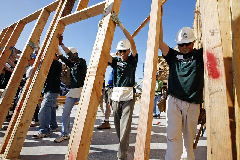 Photo of workers doing a team building event by partnering with Habitat for Humanity.