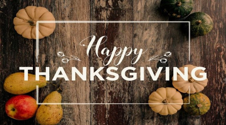 """Image of a wooden table with pumpkins and a message saying, Happy THANKSGIVING."""""""