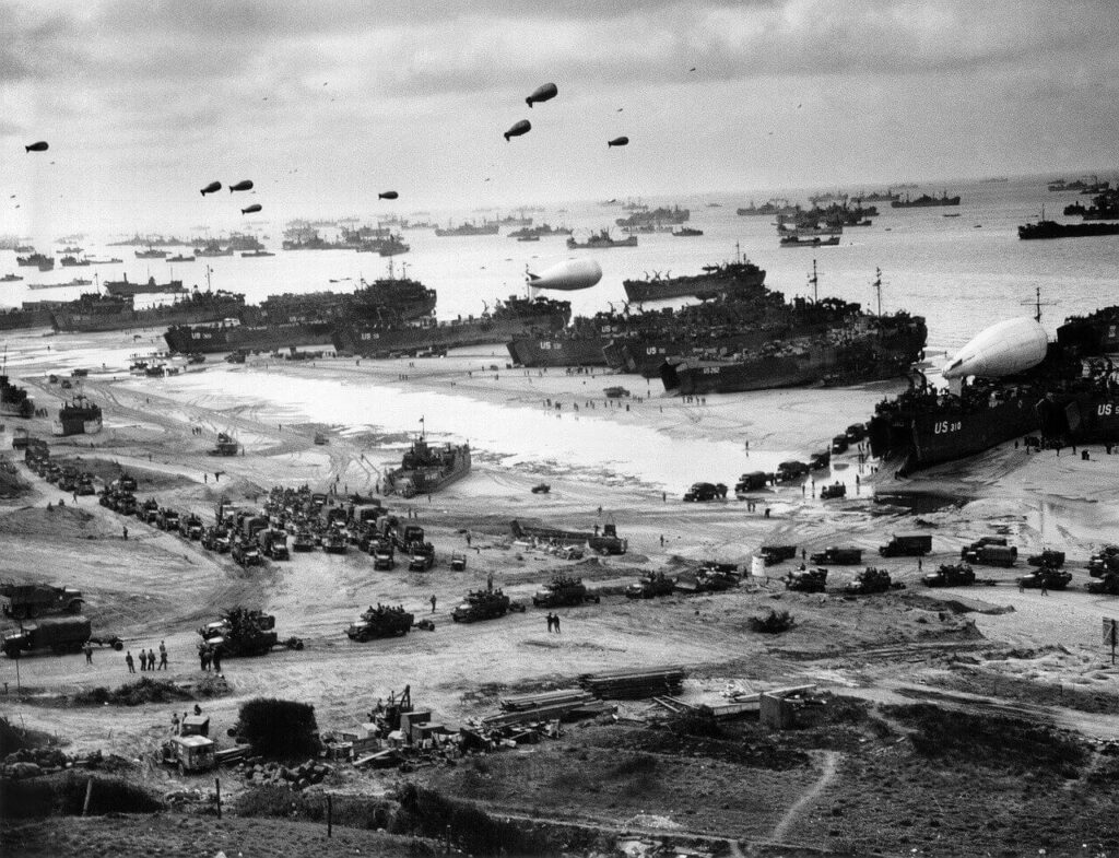 Image of troops and ships in Normandy during WW2.