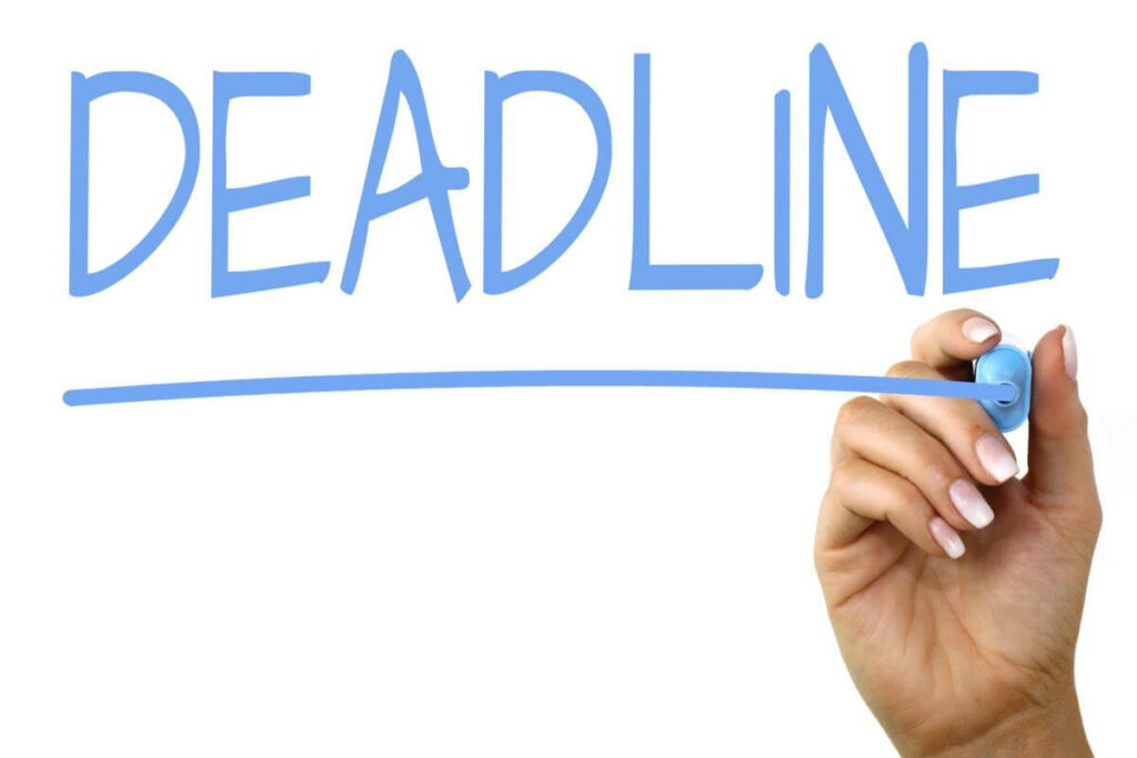 Image of the word DEADLINE written by a hand with a blue marker.