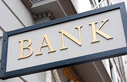 Image of the word BANK on a sign, as one alternative to employee loans.