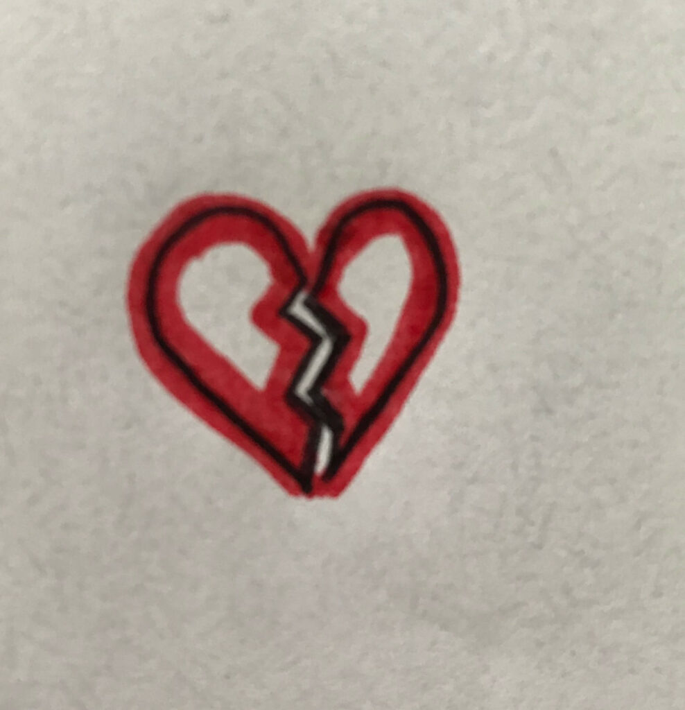 Image of a drawing of a red broken heart.