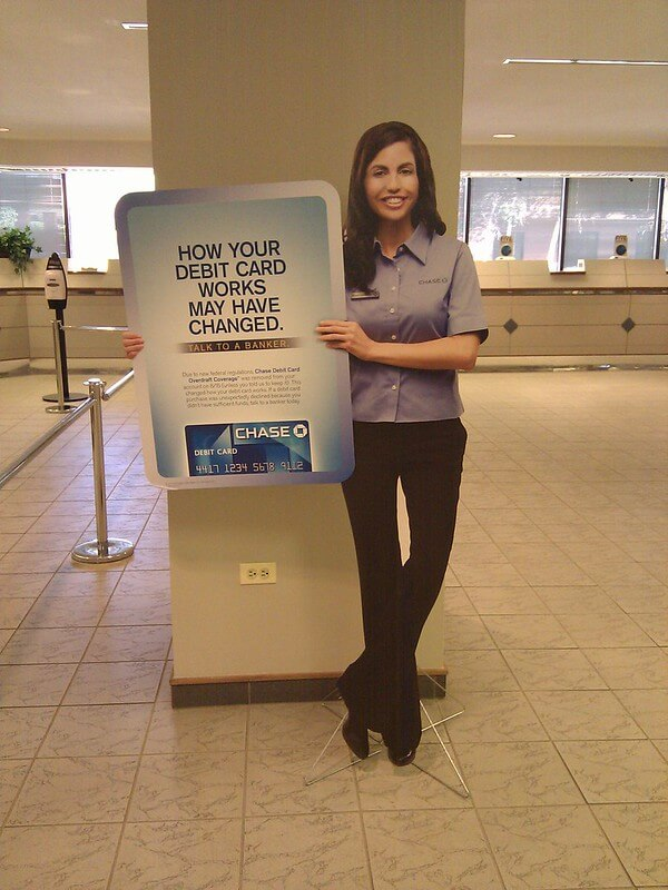 Photo of a bank teller who has been cross-trained to sell services.