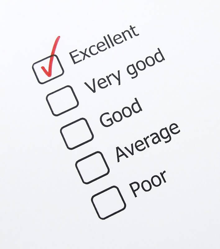 Image of a rating scale, with the word Excellent checked with a red mark.