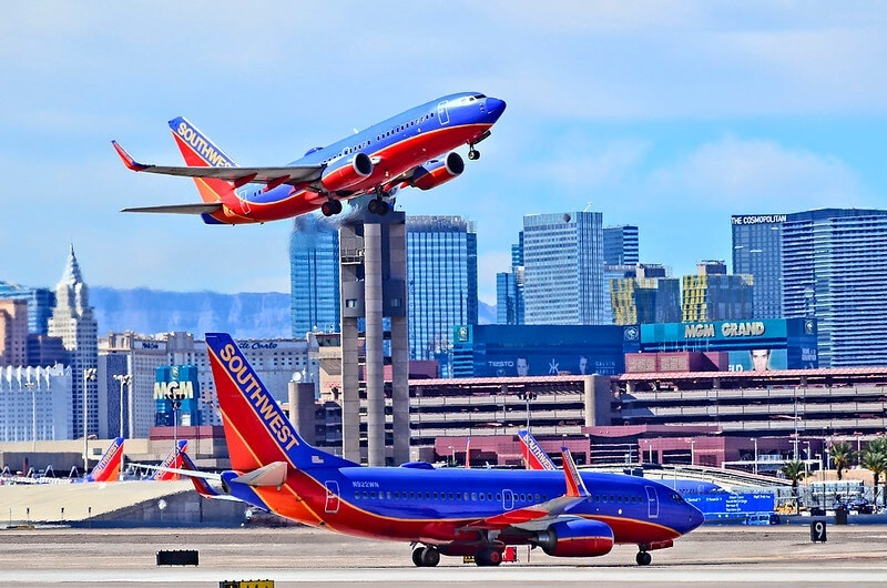Photo of Southwest Airlines airplanes taking off and landing at an airport.