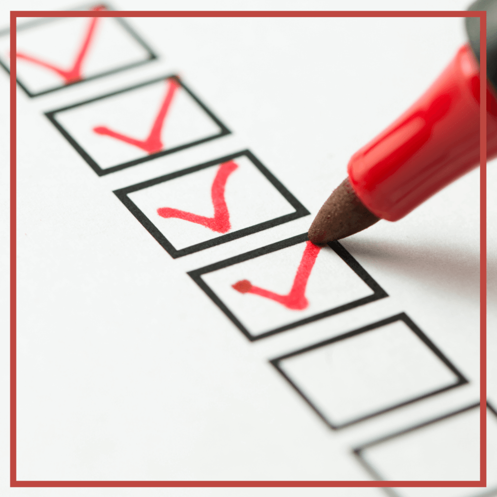 A red marker checking items off of a checklist.