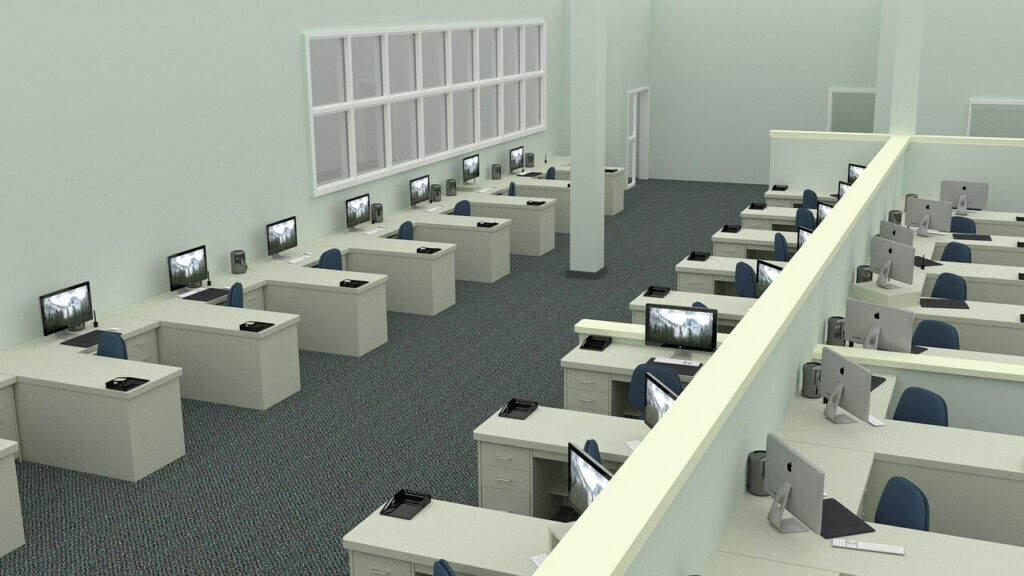 Image of rows of desks and computers in a minimalist workplace.