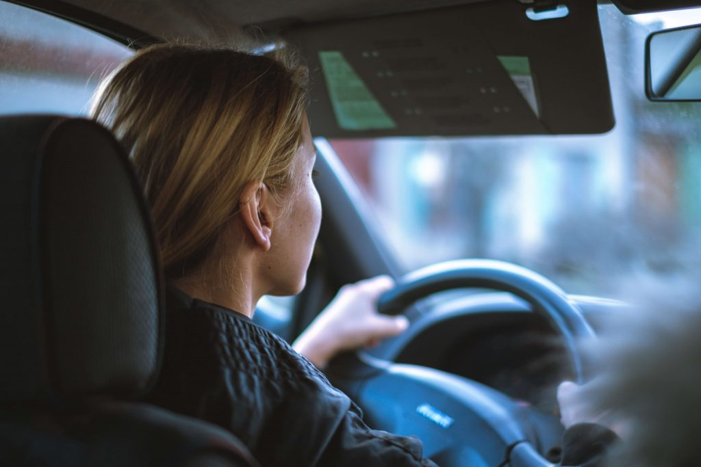 Photo of a driver behind the wheel of a car.