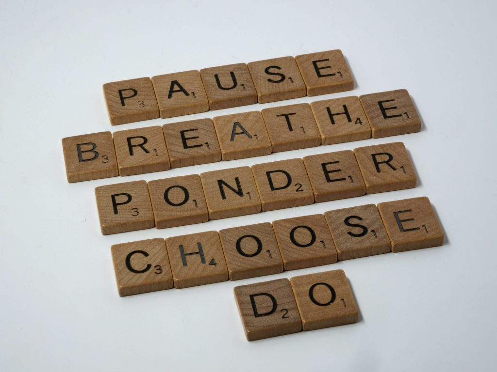 """Image of Scrabble letters spelling the words, """"PAUSE, BREATHE, PONDER, CHOOSE, and DO."""""""
