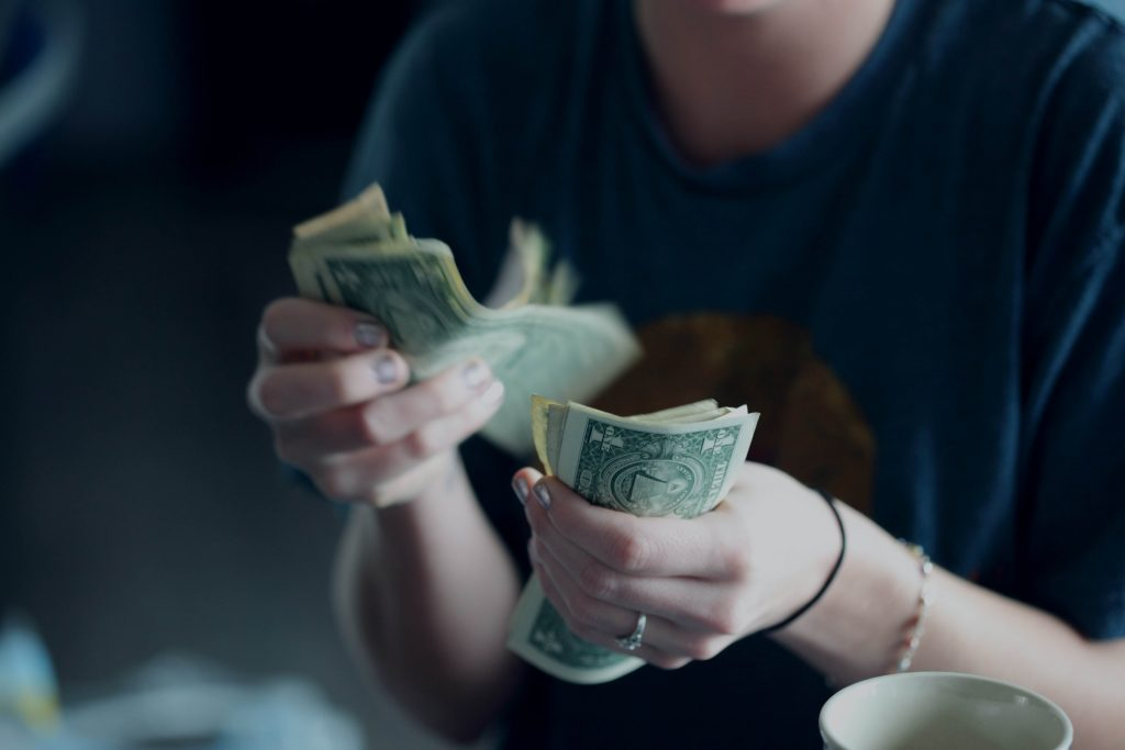 Photo of a person counting cash.