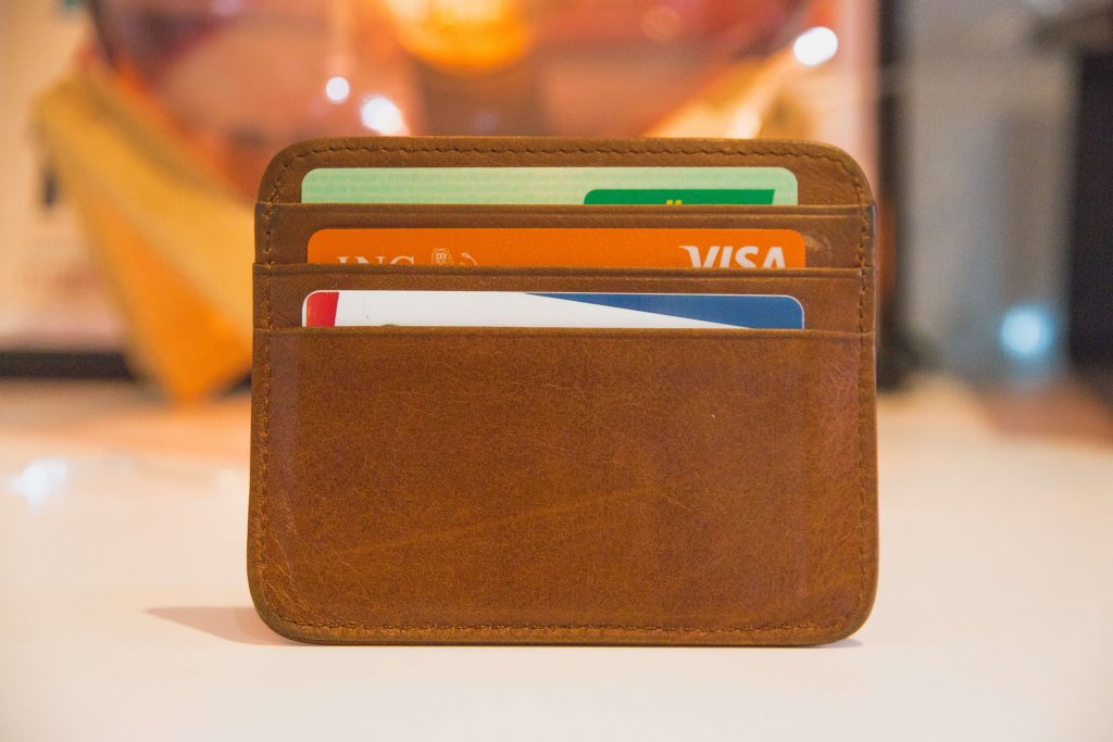 Image of a wallet with three slots, a credit/debit card in each.