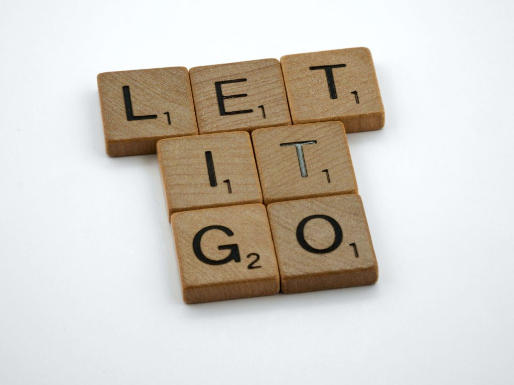 Photo of Scrabble blocks with the letters spelling LET IT GO.
